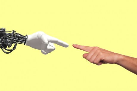Robot-Human-Hand-Public-Domain-460x306.jpg